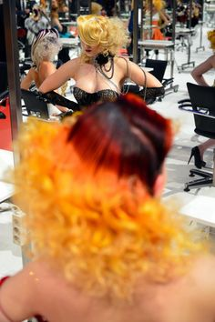 "A Model styled by a participant waits to be judged by the jury during the contest ""Day style"" of the OMC Hairworld World Cup on May 4, 2014 ..."