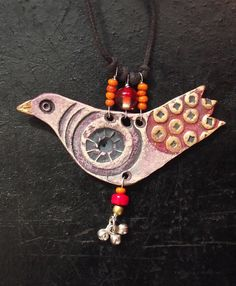clay bird necklace.  LOVE.