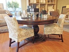 Quatrine dining: Iveston dining table and Low Back slipcovered dining chairs.