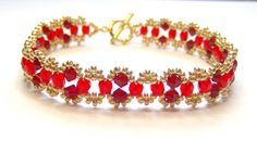 An elegant red and gold swarovski bracelet made using red siam swarovski bicones, red czech firepolish and galvanised gold seed beads and finished with a gold plated toggle clasp. Length of bracelet is 23 cm (9 inches) which is comfortable for a 7 - 8 inch wrist and the width is 1.2 cm (0.5 inches). Please check the wrist size carefully before purchasing. Bracelet will be in a black gift box and sent in a protective jiffy bag This lovely design is available in other colours here https:...
