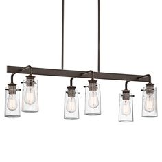 "There's so much to love about the reclaimed style of this 6 light linear chandelier from the Braelyn™ collection. The vintage industrial design is punctuated with Clear Seedy Glass shades, reminiscent of glass jars that were a staple of 19th century American life.   Glass Description: Clear Seedy Downrod Length:	36"" Base Backplate: 10.50 X 4.50 Number of Bulbs:	6 Finish: Olde Bronze"