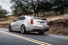 2016 Cadillac Ats V Rear Three Quarter In Motion 02