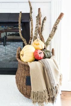 Fill a basket with sticks from your yard, a throw and multiple pumpkins for an easy fall display || Worthing Court Blog