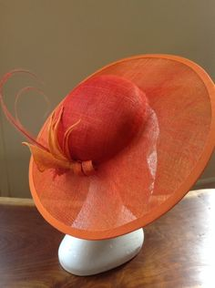 Orange ombray-dyed hatinator with hand-made, sinamay flowers and acid dipped feathers Millinery Hats, Fascinator Hats, Orange Gloves, Flapper Hat, Mad Hatter Hats, Love Hat, Cool Hats, Hair Ornaments, Derby Hats