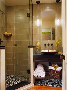 small bathroom layout, tile across all back wall, half wall shower, open shelves under sink, wood floor! (really?..cool...)