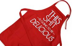 "Text on an apron: ""This shit is going to be delicious"""