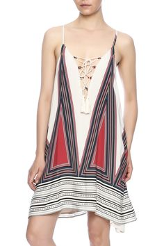 Geometric print shift dress in taupe, navy and wine featuring a deep lace up V neck with tassels. This dress is fully lined and lightweight, taking you in style from the pool to an evening out! Bahama Mama Dress by Entro. Clothing - Dresses - Casual Clothing - Dresses - Printed South Carolina