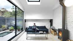 Threefold Architects updates London mews house with monochrome interiors and rustic details (Dezeen) Gaudi, Diy Terrasse, Monochrome Interior, Mews House, Folding Walls, Interior Architecture, Interior Design, Design Interiors, London Property