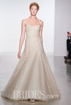 Brides.com: . Nude strapless beaded A-line wedding dress with a sweetheart neckline and floral bodice details, Christos