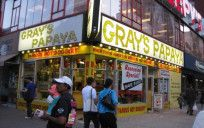 Gray's Papaya is famous in New York for its inexpensive, yet high-quality hot dogs and its fresh fruit drinks (which include papaya per the restaurant's name as well as orange, grape, piña colada, coconut champagne (non-alcoholic), and banana daiquiri (non-alcoholic)). Grey's Papaya has three locations - this one is found at 2090 Broadway at 72nd Street. This location has been featured in several films, including The Warriors, Die Hard With a Vengeance,You've Got Mail and Fools Rush In.