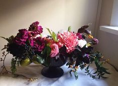 This is a stunning low rise flower arrangement - perfect for a wedding setting