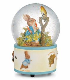"peter rabbit™ musical snow globe - This darling glass globe features Peter Rabbit snacking on his favorite food, and is decorated around the base with more beloved Beatrix Potter characters. Shake it and the globe fills with glitter; wind it up to hear ""Ode to Joy."" 6"" tall."