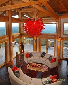 Interior of a round log post and beam home I designed in North Carolina, built…