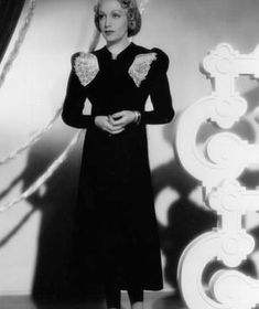 1936 This glamorous look may have been influenced by Italian designer Elsa Schiaparelli, who loved embellishment as much as she did strong s...