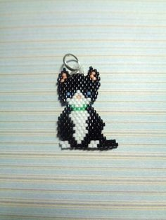 Perfect for any cat lover! for yourself or as a gift Handmade charm in brickstitch by using high quality miyuki bead delicas in different colours Double ring, clasp, keyring ore necklace are nickelfree the cat is 3.5 cm (1 3/8) x 2 cm (13/16) In the last picture you can see the examples of the different styles, can also be made as earrings, please mail me the necklace will be leather and 46 cm long (18) With the clasp you can hang it on your bracelet or on to another necklace th...