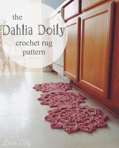 crochet doily rug using the dahlia doily pattern, using Fettuccini fabric yarn by Lion Brand