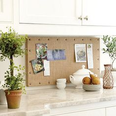 Burlap Message Board - like this board. Also like that there isn't a tile backsplash. You never see that anymore.