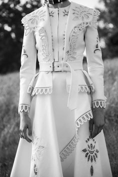 A Victorian inspired ivory jacket with graphic broderie anglaise details,  worn with a foulard drape 7a8aa753424