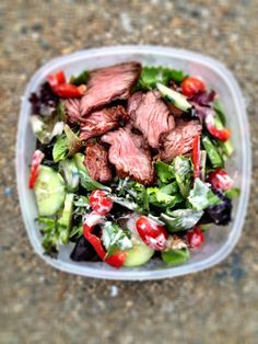 Steak salad vegetable base (3 large handfuls mixed greens, ½ cup chopped bell pepper, ½ cup chopped cucumber, ½ cup shredded carrot, 6-8 cherry tomatoes=50 calories) + 3 ounces marinated and grilled beef sirloin tips leftover from dinner the previous night, thinly sliced (210) + 3 tablespoons Ken's Lite Caesar dressing (120) = 380