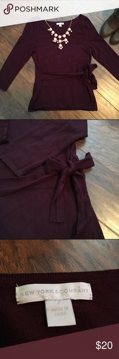 Cute burgundy 3/4 sleeved tie sweater This sweater is super cute! It is a deep burgundy color and ties to the side. It is 3/4 sleeve and perfect for the winter time. New York & Company Sweaters