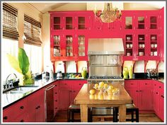 My kitchen cabinets were very similarly painted just a tad more rosey and not so hot-pinky when we first moved in the house.  I should have kept them that color lol