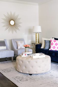 gold spike mirror in living room. love the tufted ottoman