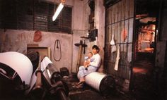 father and baby in threading factory