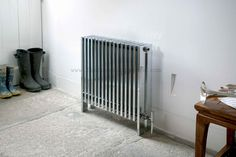 This ultra-modern XL radiator works as a complete contrast to the original stone floor.