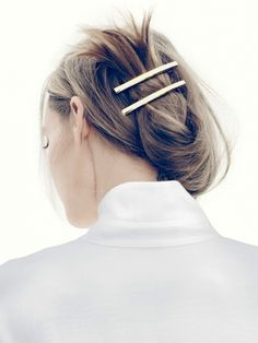 casual up-do with brass barettes