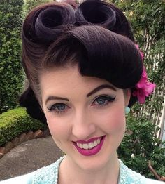 brunette pin up roll updo