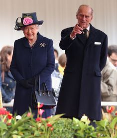 Queen Elizabeth II and Prince Philip, Duke of Edinburgh smile as they welcome the President of Singapore Tony Tan Keng Yam (not seen) at Horseguards on October 21, 2014