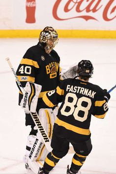 BOSTON, MA - JANUARY 26: Tuukka Rask #40 and David Pastrnak #88 of the Boston Bruins celebrate the win against the Pittsburgh Penguins at the TD Garden on January 26, 2017 in Boston, Massachusetts. (Photo by Steve Babineau/NHLI via Getty Images)