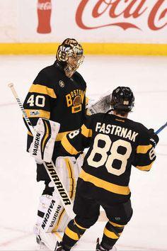 BOSTON, MA - JANUARY 26: Tuukka Rask #40 and David Pastrnak #88 of the Boston Bruins celebrate the win against the Pittsburgh Penguins at the TD Garden on January 26, 2017 in Boston, Massachusetts. (Photo by Steve Babineau/NHLI via Getty Images)
