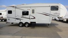 28ft - 2009 - North Trail by Heartland - $17,995.00  This is one sweet 2009 28ft light weight fifth wheel North Trail by Heartland! Weighing in fully loaded at only 6900 this one could even be pulled by a half ton truck! The whole family will love camping trips this summer! Visit http://BudgetRVsOfTexas.com to see more great RVs for sale