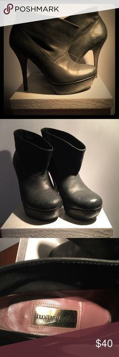 "Distressed Black Booties by Luxury Rebel Genuine distressed leather booties with 4 1/2"" stiletto  heels. Very good condition with only flaws on the right heel. See pic 3.  Pls check out my closet! Luxury Rebel Shoes Ankle Boots & Booties"