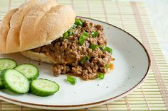 Peanut Butter Satay Sloppy Joes With Coconut Milk, Peanut Butter, Beef Broth, Fresh Lime Juice, Rice Vinegar, Brown Sugar, Thai Red Curry Paste, Fish Sauce, Diced Red Onions, Garlic, Fresh Ginger, Lean Ground Beef, Hamburger Buns, Chopped Cilantro, Sliced Green Onions