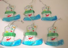 Handmade fused glass snowman ornaments decoration for holidays set of 6 snowman. $9.99, via Etsy.