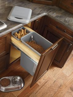 Storage aficionados will love being able to have a place for everything, including a beloved pet's food. (Base Wastebasket with lid, by Diamond) http://www.diamondcabinets.com/