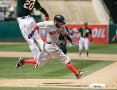Boston Red Sox's Dustin Pedroia runs safely to first base as Oakland Athletics first baseman Mark Canha leaps for the throw in the eighth inning of their baseball game Wednesday, May 13, 2015, in Oakland, Calif. The Red Sox scored a run on the play and Athletics shortstop Marcus Semien was given a throwing error on the play. (AP Photo/Eric Risberg) Boston Red Sox Team Photos - ESPN