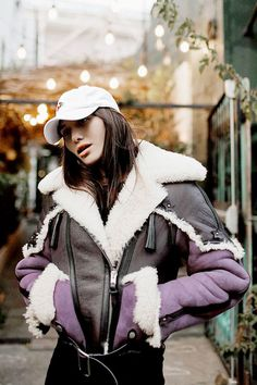 The next combo you should try this winter: baseball hat + shearling moto jacket.
