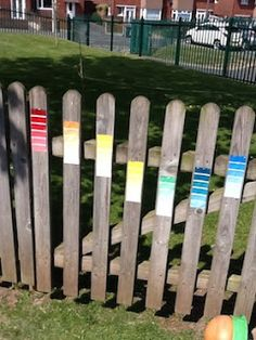 paint swatches attached to fence panels, laminate first then stick, don't nail as rain gets into laminate