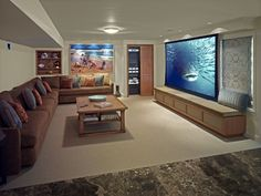 Fun filled room, We now have a space that is useful and fun!, space with screen down-great Wii playing, Basements Design