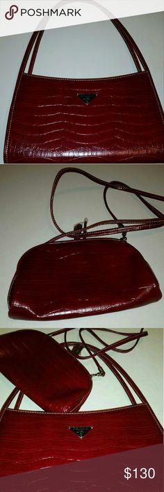 Brand new never used red Prada purse Brand new and never used (not big enough for my taste). Comes with a small pouch that has a detachable crossbody, pouch could be used as a mini purse, coin holder, phone/money holder, makeup pouch, etc. Prada Bags