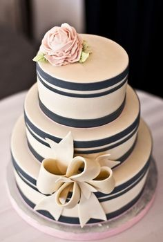 Navy and Pink striped cake with bow and rose by The Girl With the Most Cake. Canadian Museum of Civilization Wedding by Marry Me Productions. Wedding Photography by Union Eleven Gorgeous Cakes, Pretty Cakes, Cute Cakes, Amazing Cakes, Cake Cookies, Cupcake Cakes, Striped Cake, Gateaux Cake, Fancy Cakes
