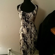 Ohh la la. This Ann Taylor dress will turn heads. Stretchy form fitting over those curves. Black and white halter dress. Ann Taylor Dresses Midi