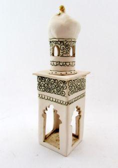 the oasis - merrie tomkins...ceramic artist bell tower