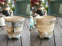 Whimsical altered tin pails of Lisa Kaus.  Would be cute holding your paint brushes.