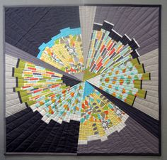 Petal Pinwheels challenge quilt by Terry Aske. Made with improvisational wedges; see the in-process photos at the link