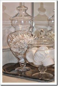 Bathroom countertop, jars on silver tray