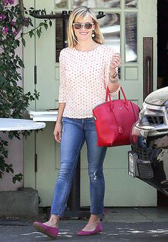 All smiles! Witherspoon emerged on April 26 wearing a red and white polka dot printed shirt with blue denim cigarette pants. A red leather Louis Vuitton bag and magenta Alice + Olivia ballet flats completed her chic look.